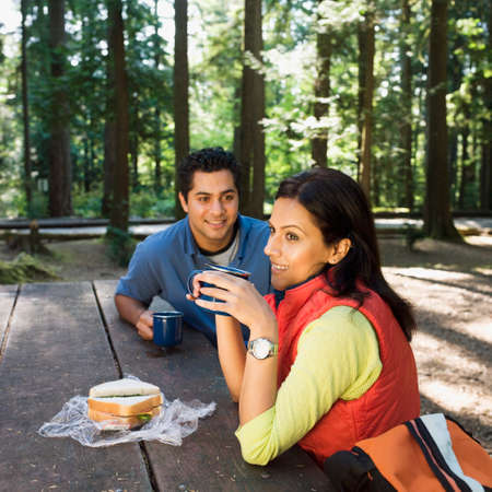 ceasing: Indian couple eating lunch in woods