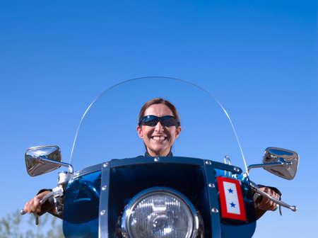 prevailing: Hispanic woman sitting on motorcycle