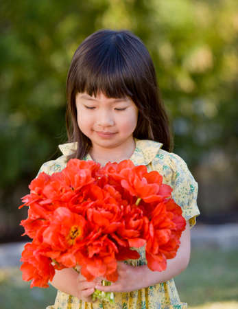 bestowing: Asian girl holding bouquet of flowers
