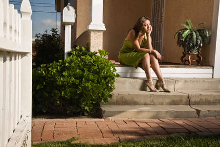 one teenage girl only: Hispanic teenaged girl in evening gown