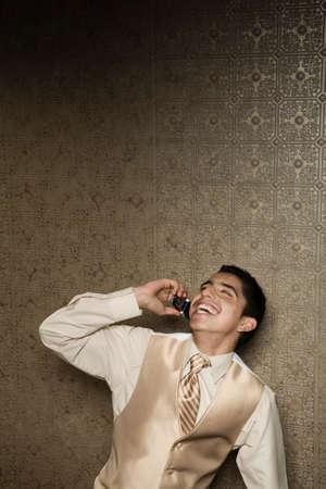 connexion: Hispanic teenaged boy talking on cell phone