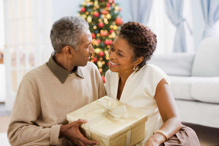 ostentatious: African couple holding Christmas gift