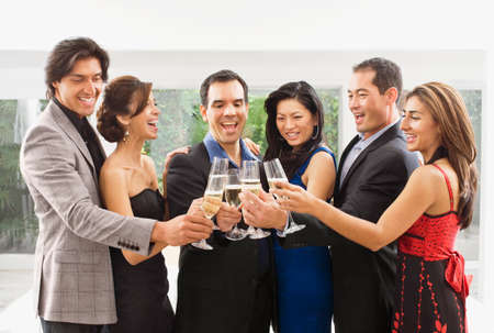 Multi-ethnic couples toasting with champagne Stock Photo