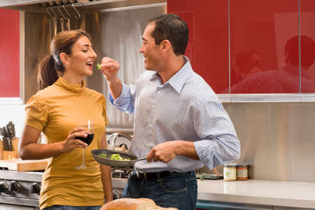 attentiveness: Multi-ethnic couple tasting food