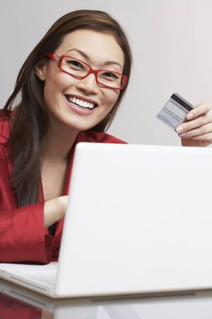 commercialism: Asian businesswoman shopping online