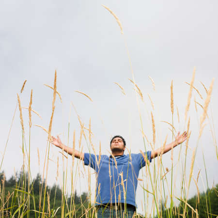 ceasing: Indian man with arms outstretched LANG_EVOIMAGES