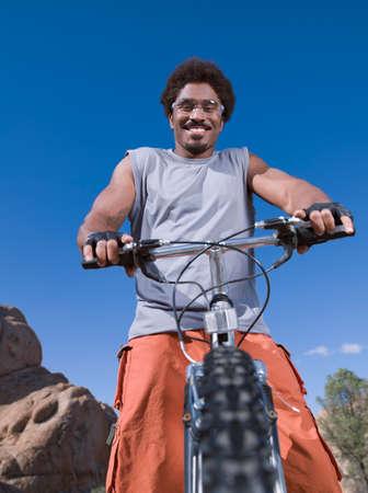 road cycling: African man on mountain bike