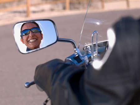 latina america: Hispanic woman sitting on motorcycle