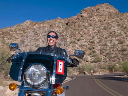 adventuresome: Hispanic woman riding motorcycle LANG_EVOIMAGES