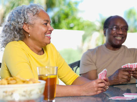Senior African couple playing cards Stock Photo