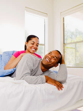 african american couple: African couple hugging in bed