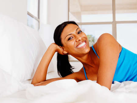 pj's: Indian woman laying on bed