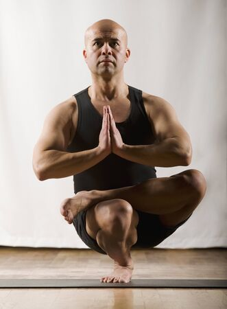 seriousness skill: Hispanic man practicing yoga