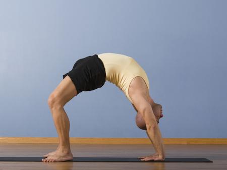 strategizing: Hispanic man practicing yoga