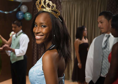 prom queen: African teenaged girl wearing tiara at prom LANG_EVOIMAGES