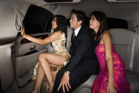 Multi-ethnic friends sitting in limousine