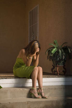 teenaged girl: Hispanic teenaged girl with head in hands