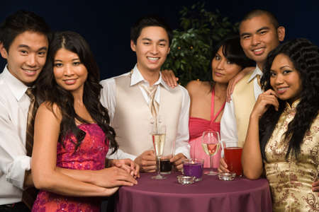Multi-ethnic couples at party Stock Photo