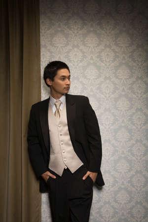 milepost: Asian man wearing suit LANG_EVOIMAGES