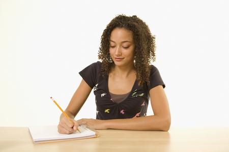 African woman writing in notebook Reklamní fotografie - 35788313