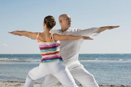 Hispanic couple practicing yoga Banco de Imagens