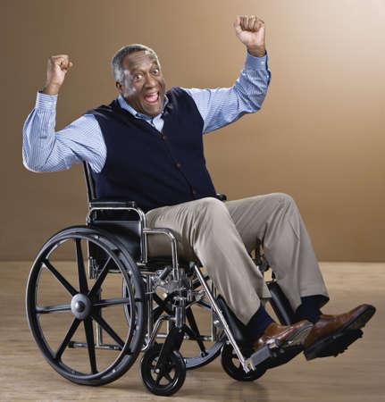 personal shopper: African man cheering in wheelchair