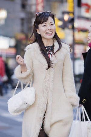 hailing: Asian woman in urban scene