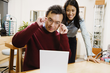 grampa: Asian man trying on eyeglasses