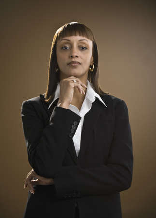 low spirited: Portrait of African businesswoman LANG_EVOIMAGES