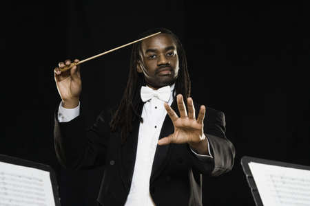 seriousness skill: African male conductor holding baton