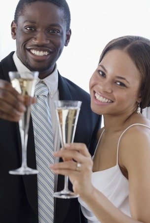 milepost: African newlyweds toasting with champagne