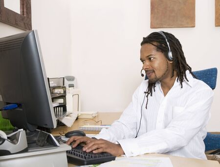 African businessman wearing headset Stock Photo