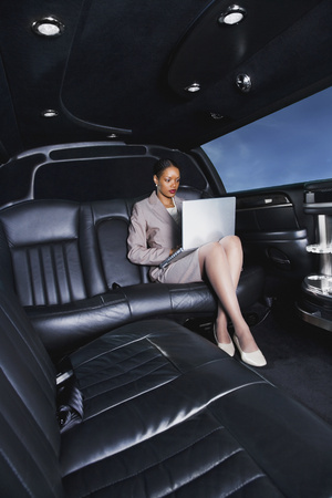 go inside: African businesswoman typing on laptop