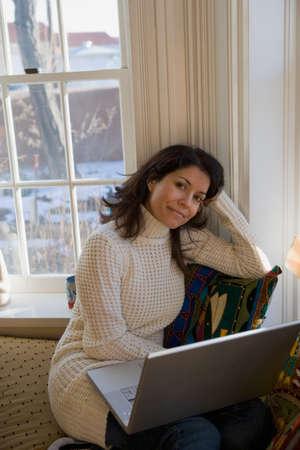 daydreamer: Hispanic woman with laptop
