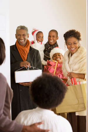 45 to 50 years old: African family arriving with Christmas gifts