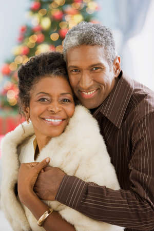 middle age couple: African couple hugging on Christmas