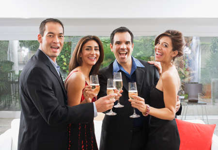ostentatious: Multi-ethnic couples toasting with champagne LANG_EVOIMAGES