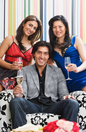 wooing: Multi-ethnic friends holding champagne