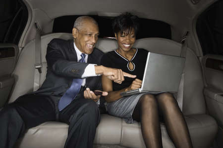 phone conversations: African businesspeople looking at laptop