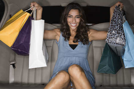 poppa: Middle Eastern woman holding shopping bags in limousine