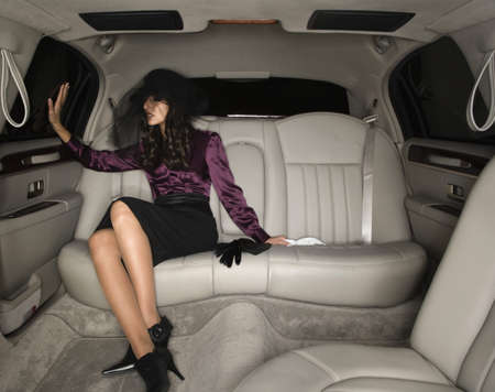 Middle Eastern woman sitting in limousine Stock Photo