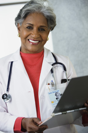 liable: African female doctor with medical chart