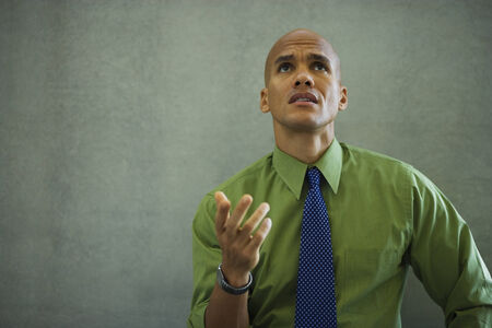 go inside: Mixed race businessman gesturing and looking frustrated LANG_EVOIMAGES