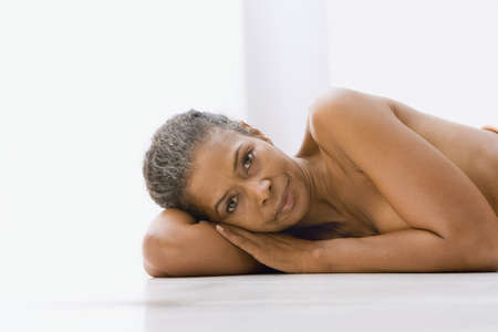naked african: Mixed race woman laying on floor naked