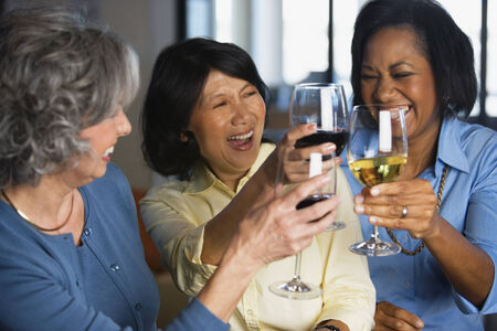 Multi-ethnic women toasting with wine