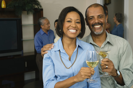 grampa: African couple toasting with drinks