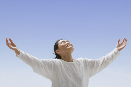 Asian woman with arms outstretched