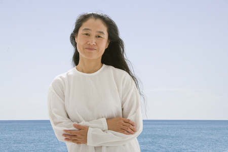 Asian woman in front of water