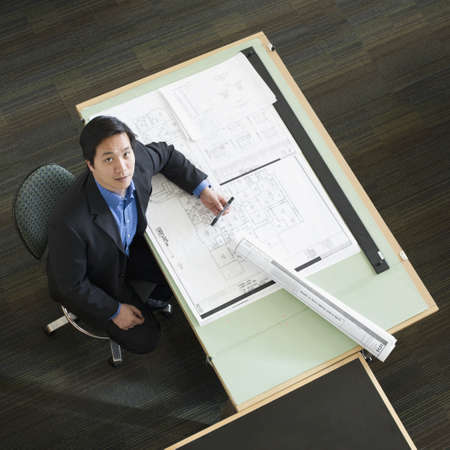 asian architect: Asian male architect with blueprints