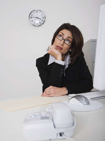 bathtowel: Hispanic businesswoman sitting at desk